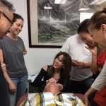 Michelle Gellis demonstrates cosmetic acupuncture techniques while CEU students observe