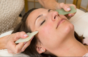 Facial Gua Sha training demonstration